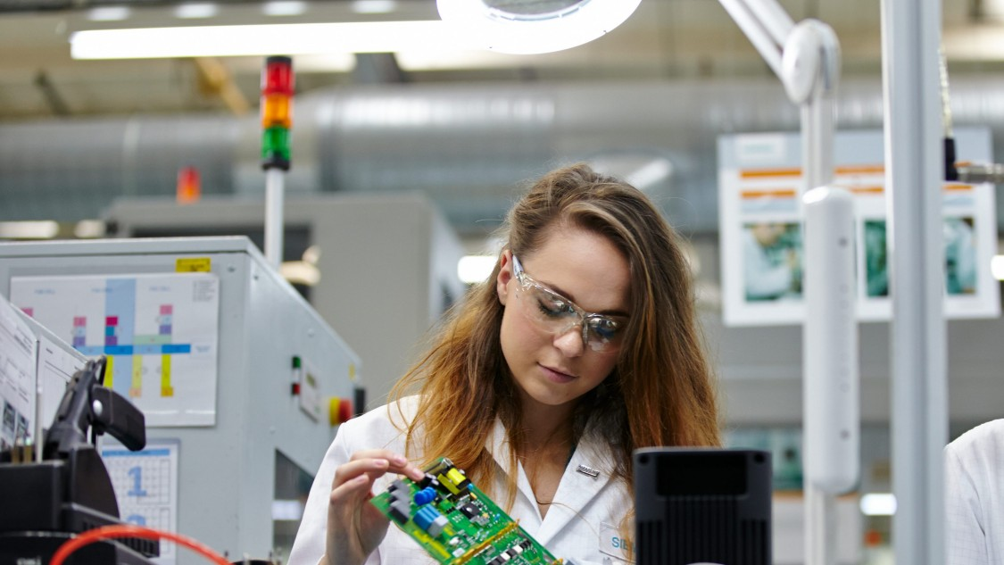 Lady working with PCB at Siemens Congleton
