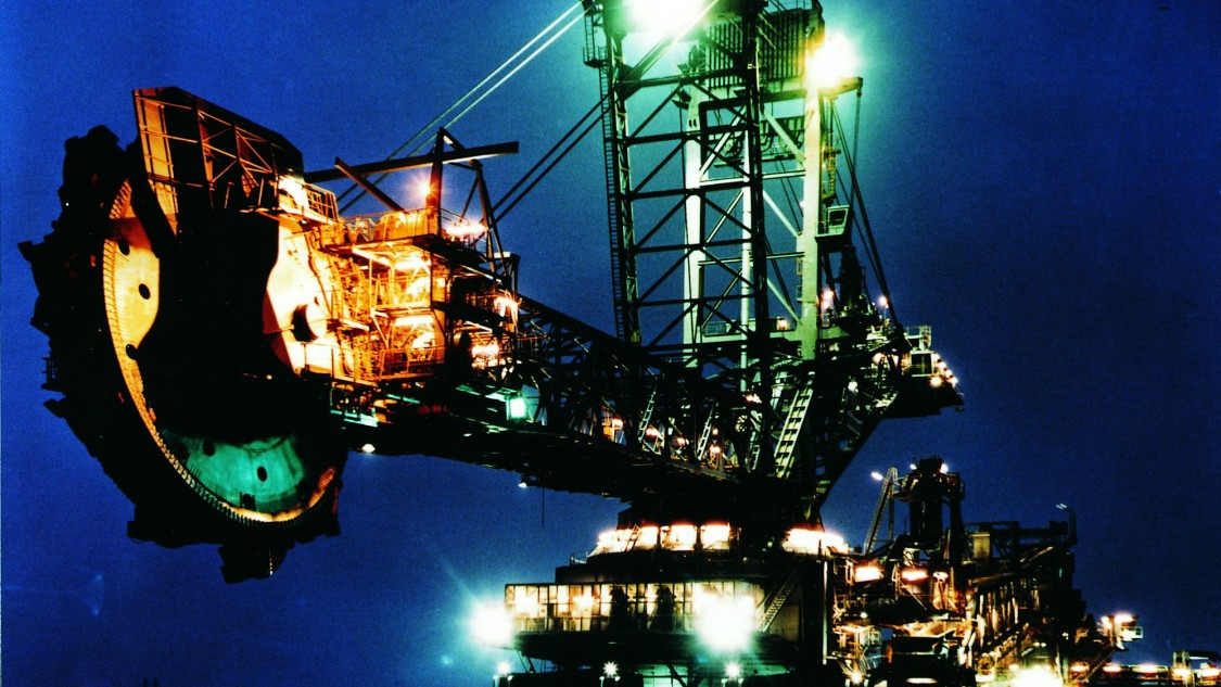 Image of an excavator by night
