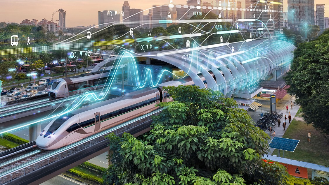 An external perspective of a modern train station in a modern, green city with digital graphic elements