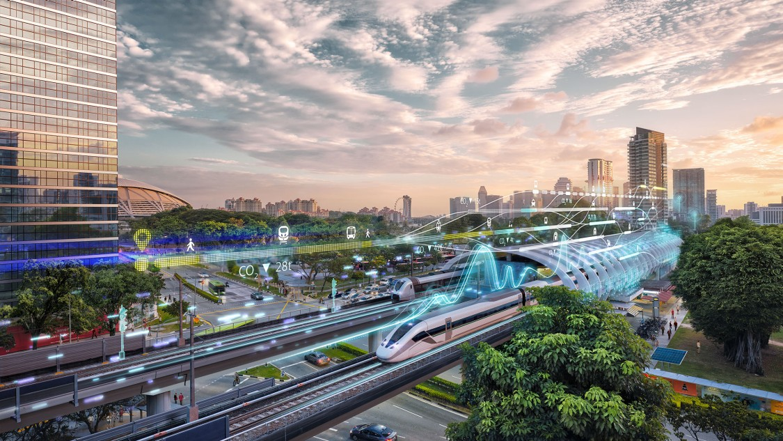 A train pulls into an ultra-modern station in a green, sustainable city; the image is overlaid by digital elements representing smart seamless mobility
