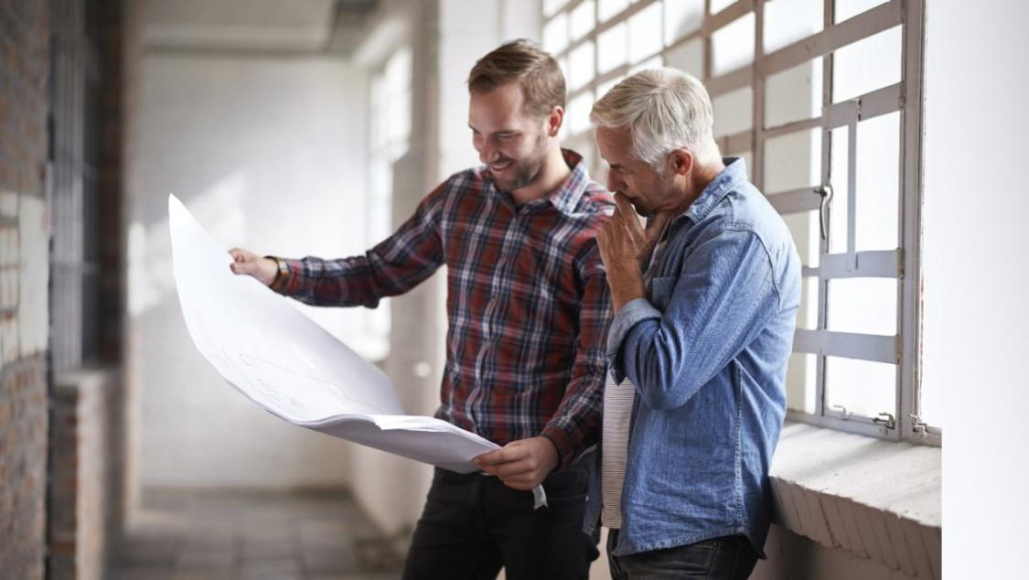 Two men over a blueprint