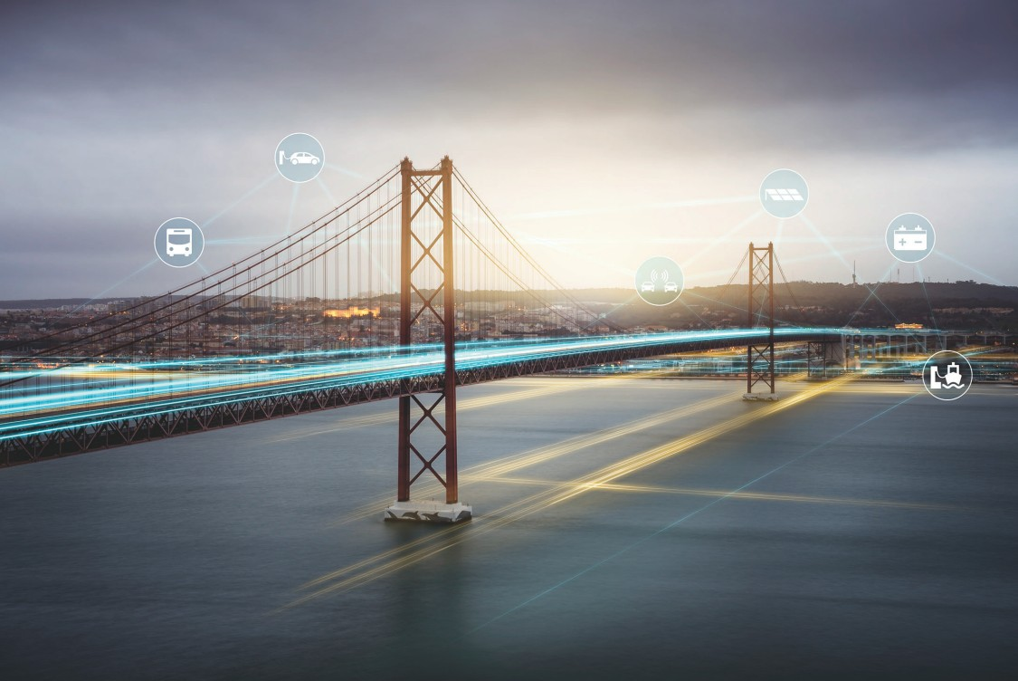Image of bridge with digital layers of transportation and energy icons