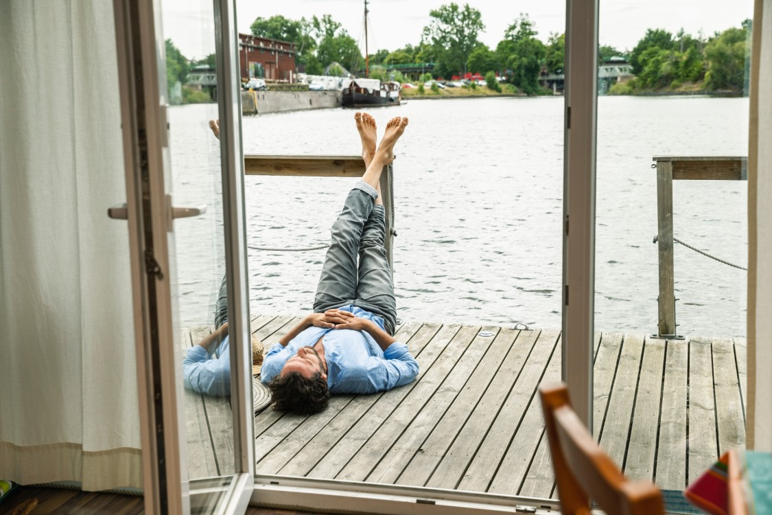 Person lying down on a deck