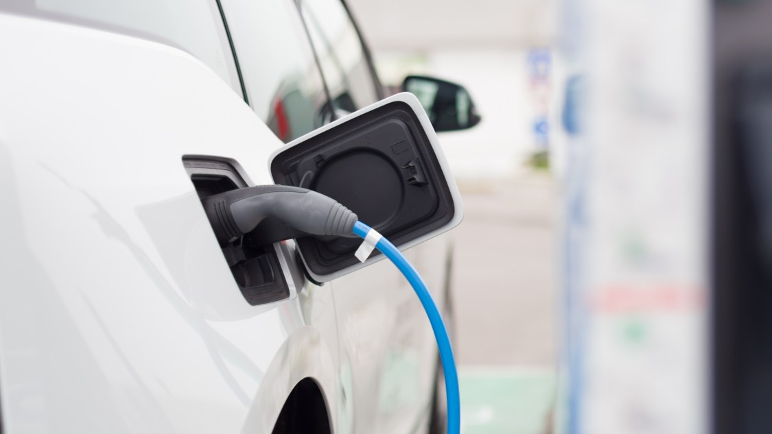 Electric Vehicle Adoption and Public Charging