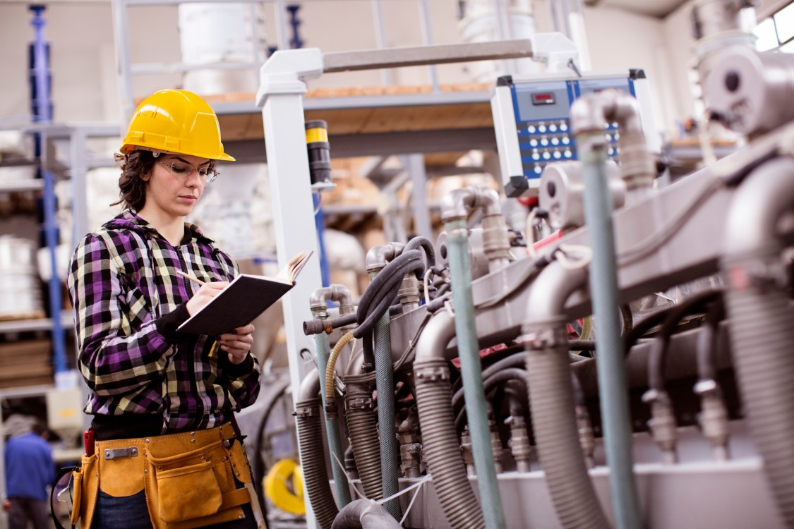 Women engineer working in a factory