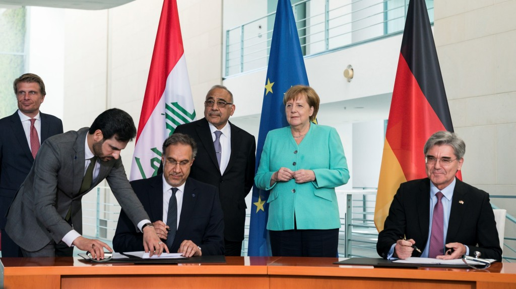 Signing of an implementation agreement to kick off the actual execution of the roadmap agreement for Iraq by Joe Kaeser, President and CEO of Siemens AG, and Luay al-Khatteeb, Iraq's Minister of Electricity, in Berlin in the presence of Adil Abdul-Mahdi, Prime Minister of Iraq and Angela Merkel, Chancellor of the Federal Republic of Germany.