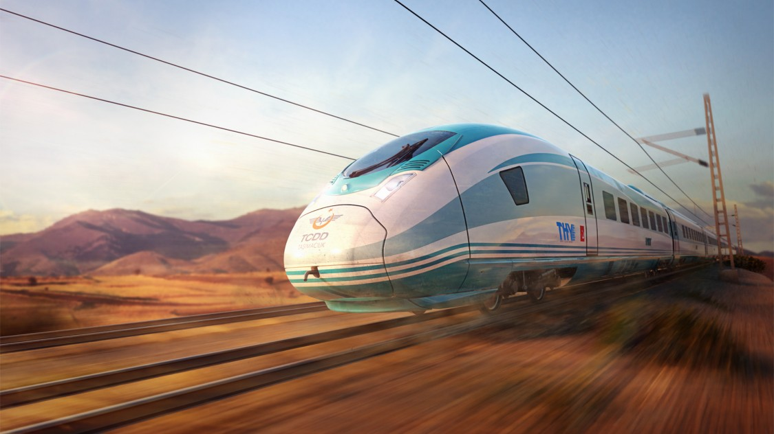 Image of the Velaro TR from Siemens Mobility in diagonal view and slight motion blur driving through a Turkish landscape.