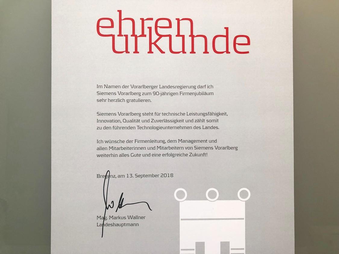 Ehrenurkunde zum 90-jährigen Firmenjubiläum von Siemens in Vorarlberg
