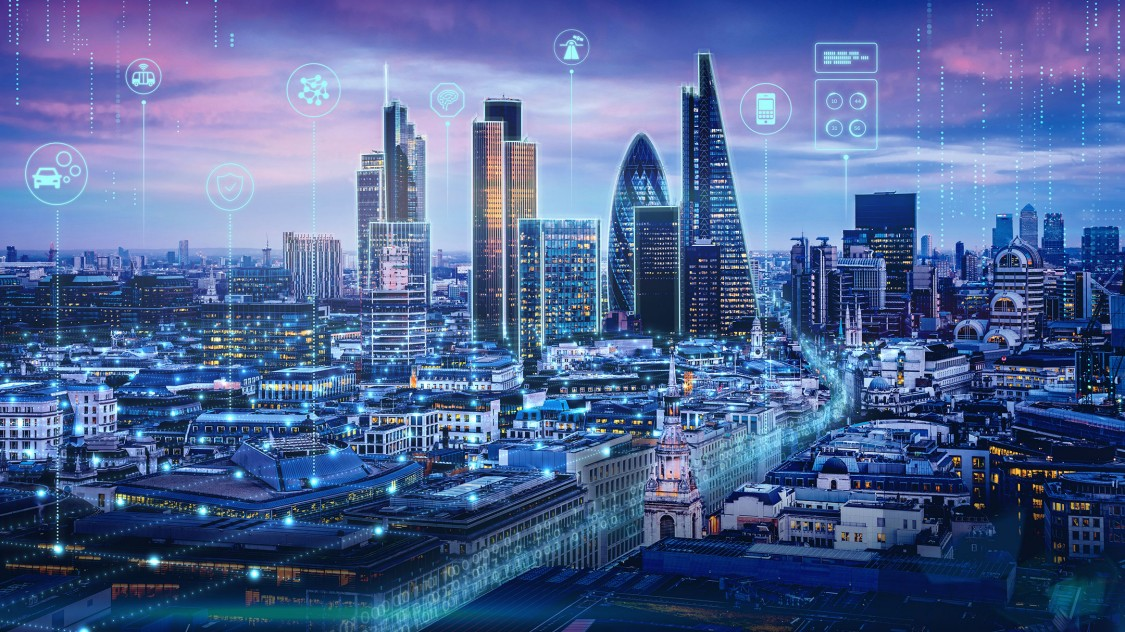 An illuminated city skyline overlaid with digital graphic elements represents how smart data, cloud technology and the digital transformation can shape smart cities