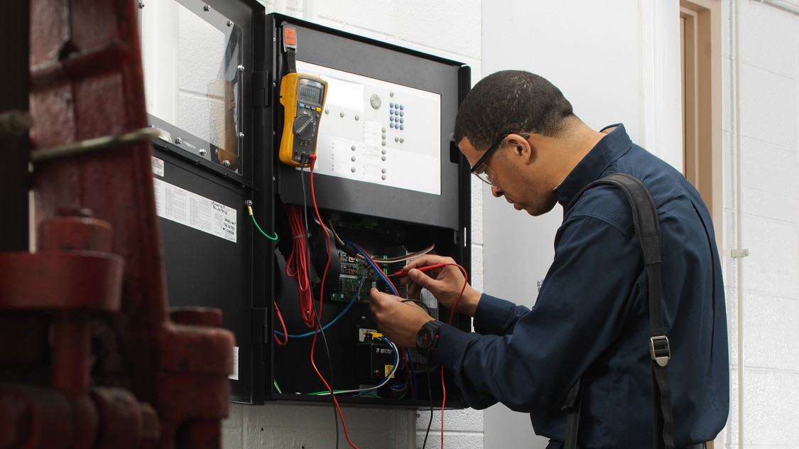 Fire Solutions technician inspecting fire products