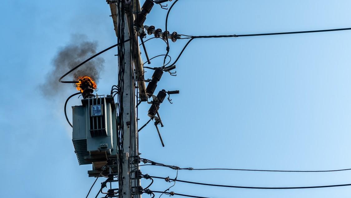 Failed transformer on fire.