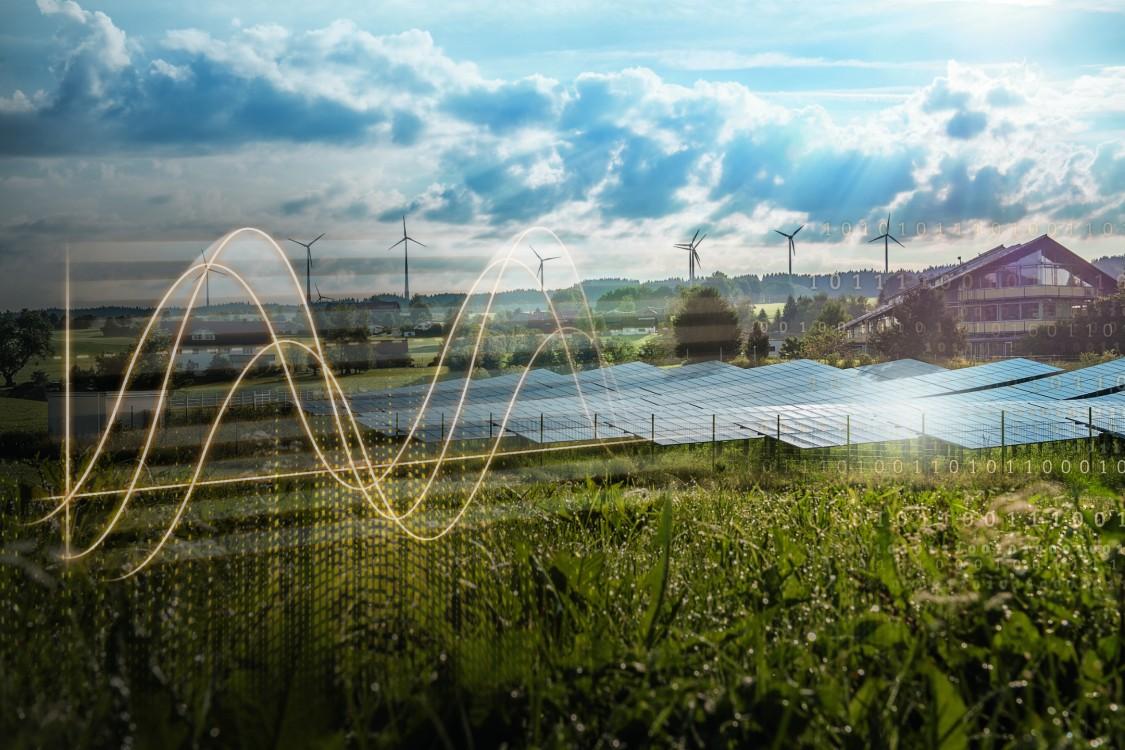 Solar panels, wind turbines and village