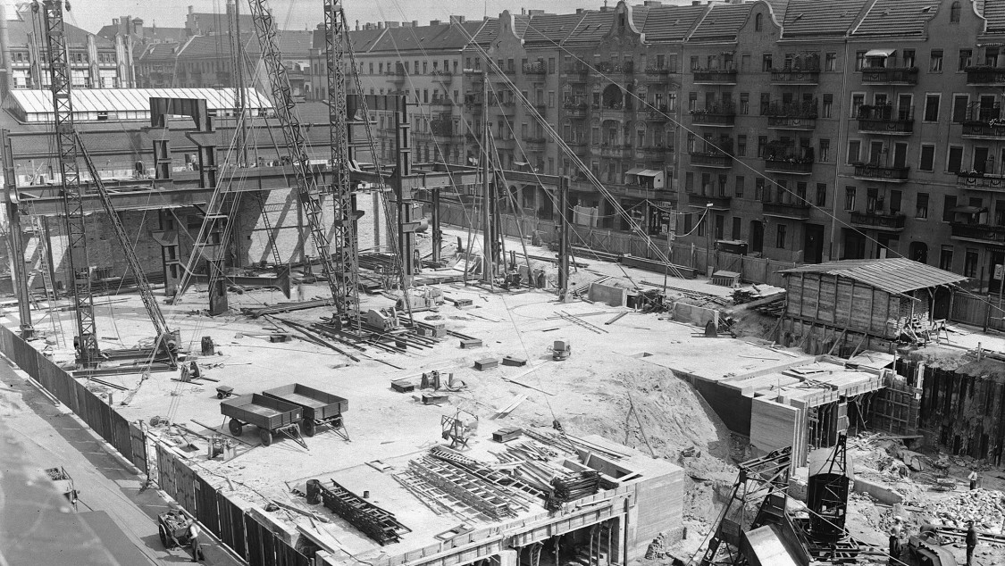 Starting at the north end, construction then began on the new extension's frame structure across the entire width of the assembly hall