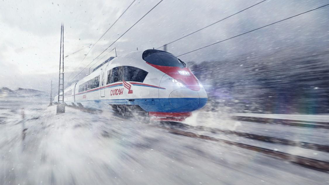 Bild des Velaro RUS von Siemens Mobility in Diagonalansicht bei der Fahrt über eine schneebedeckte Landschaft.