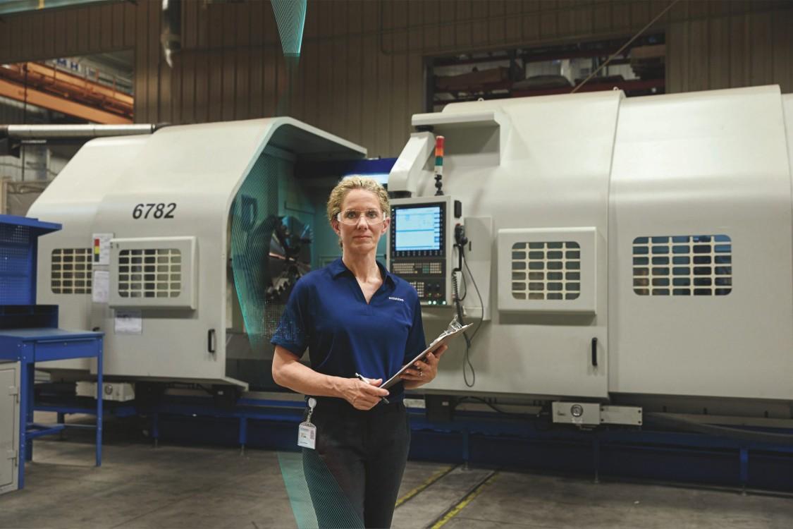 Siemens Employee Holding Clipboard in Factory