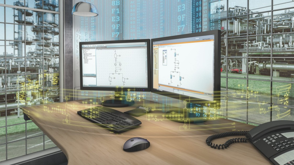 View on a desk with two monitors showing schematic processes. The monitors are surrounded digital data streams. In the background, view through windows on parts of a chemical plant.
