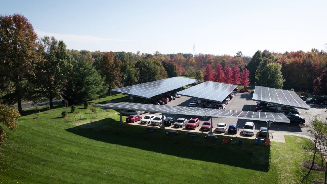 Solar array parking lot with cars parked under