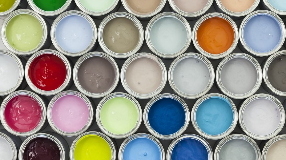 A bird's eye view of open paint pots showing the wide range of colors available.