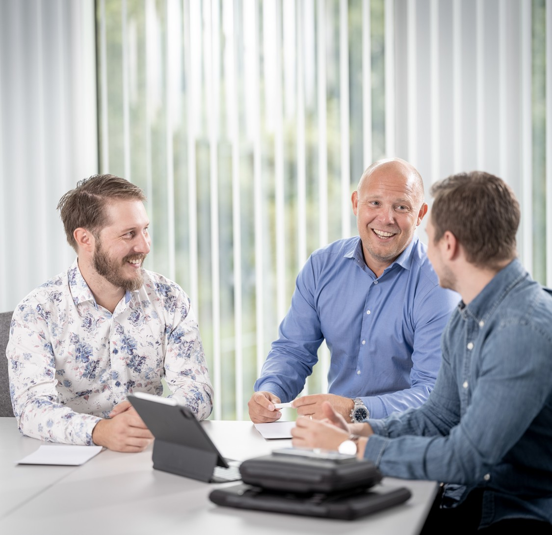 3 people in conference room