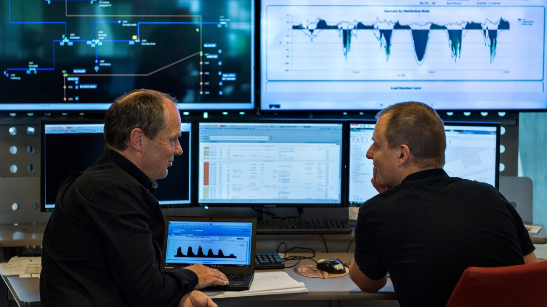 Berthelsen and Anders Warming  in the control room at Konstant Net HQ  where smart meter data is collected,  analyzed and interpreted to predict  the future load of the grid.