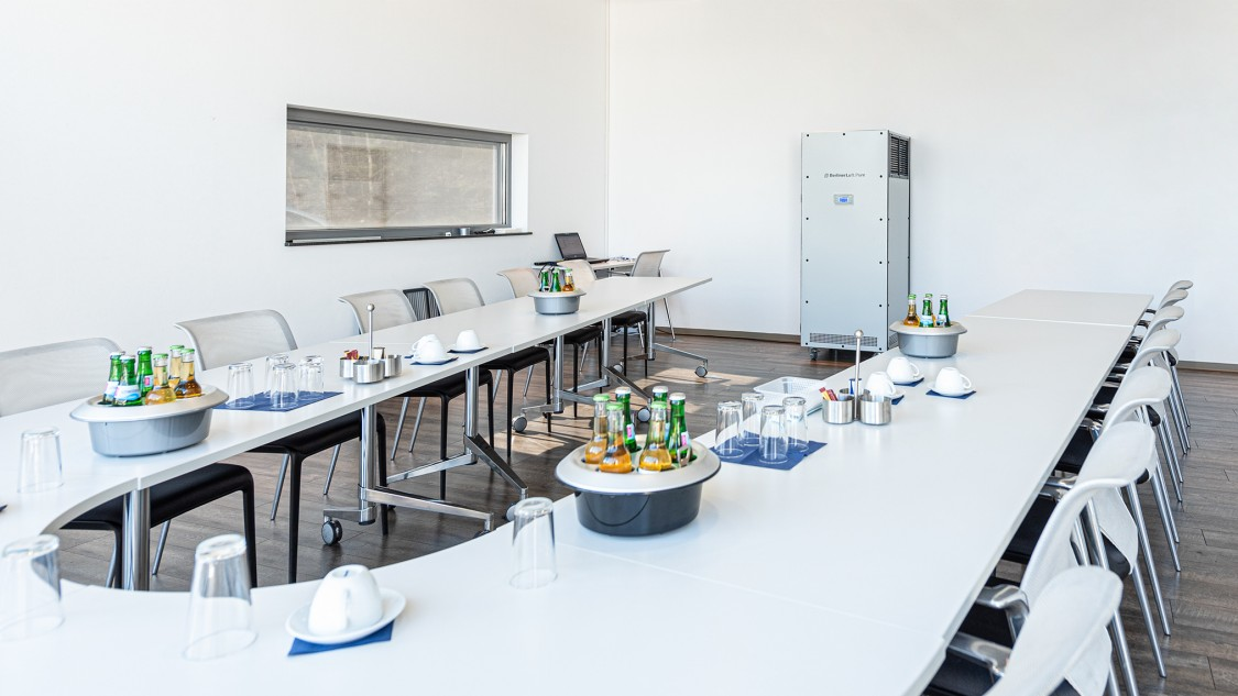 Mobile air sterilizer unit in a meeting room