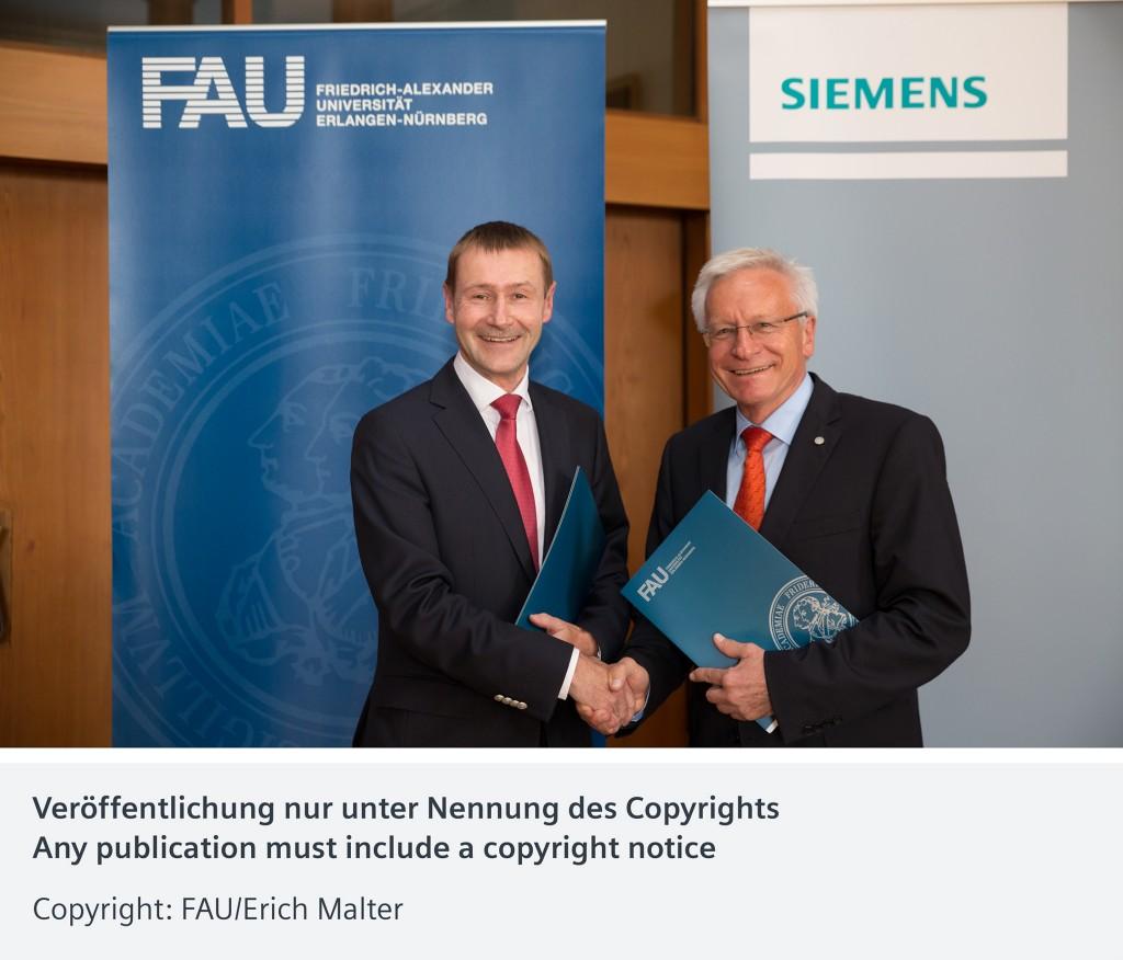Professor Karl-Dieter Grüske (right), President of Friedrich-Alexander-Universität Erlangen-Nuremberg (FAU), and Klaus Helmrich (left), Chief Technology Officer and Chief Human Resources Officer of Siemens AG