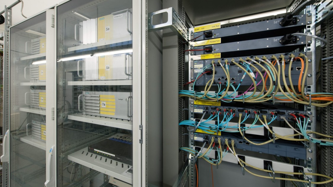 We are looking head-on at an open control cabinet: tidy, with numerous wirings.