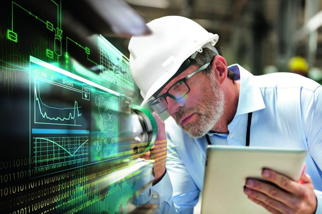 USA | Engineer inspecting equipment