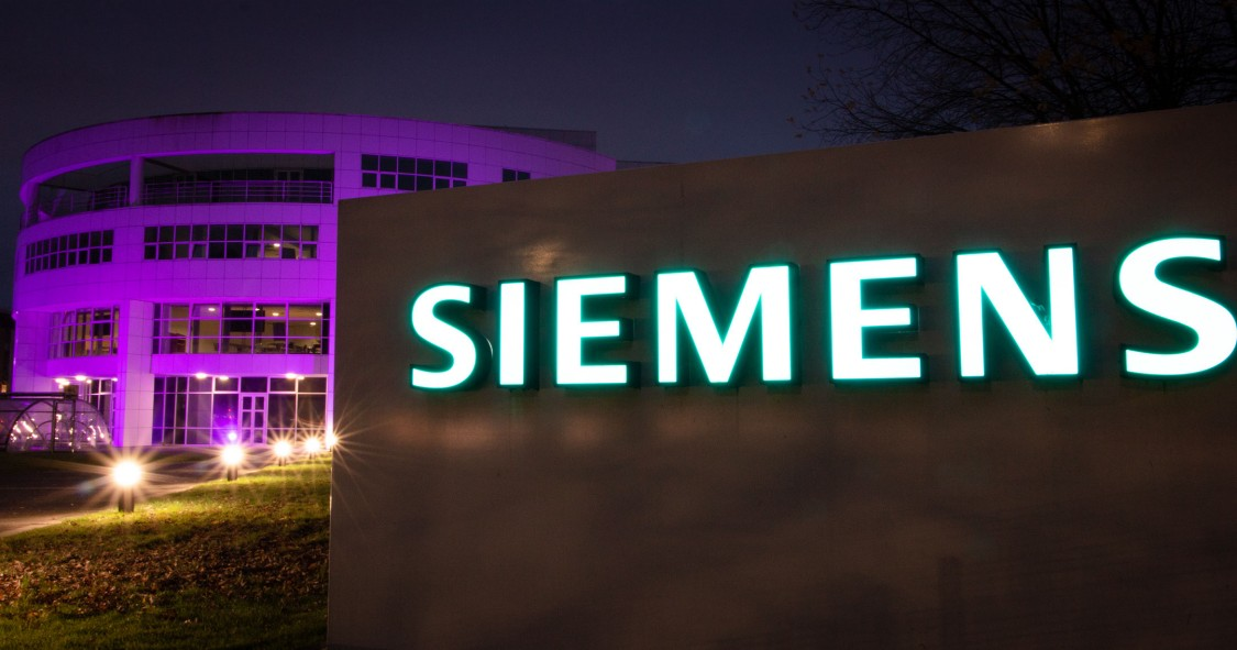 Manchester Siemens site lit up purple
