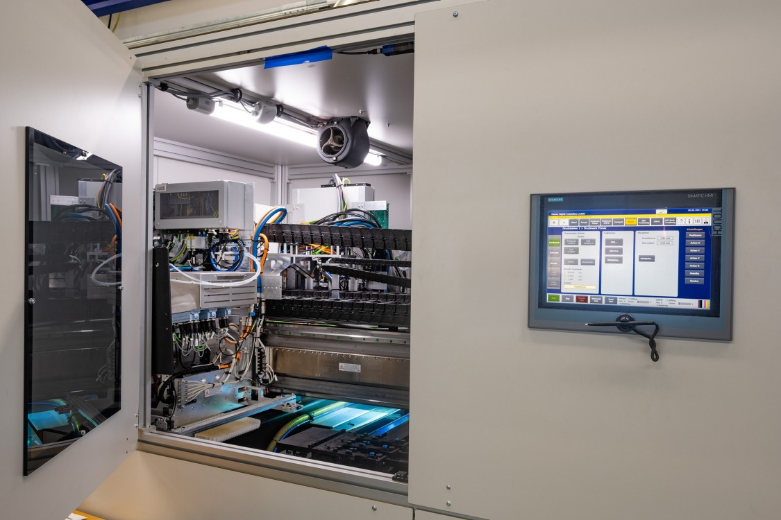 Prototype system with test printing unit and distributed control cabinet