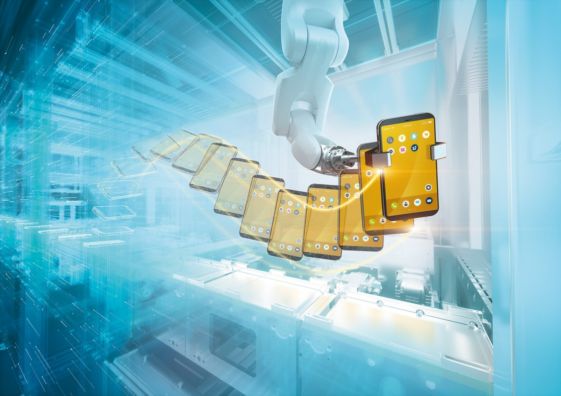 Factory automation innovation - digital, AI integration of robotic arm holding a cell phone