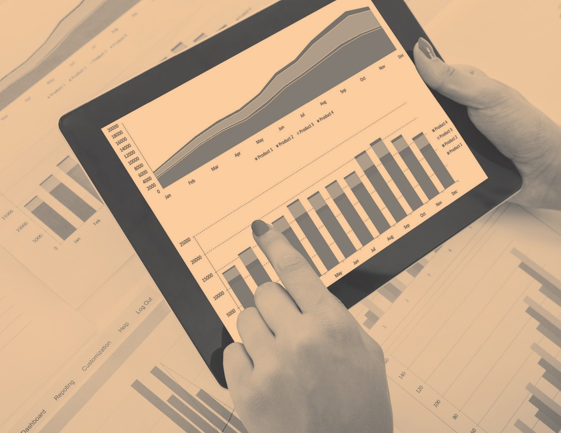 person holding tablet with graph chart