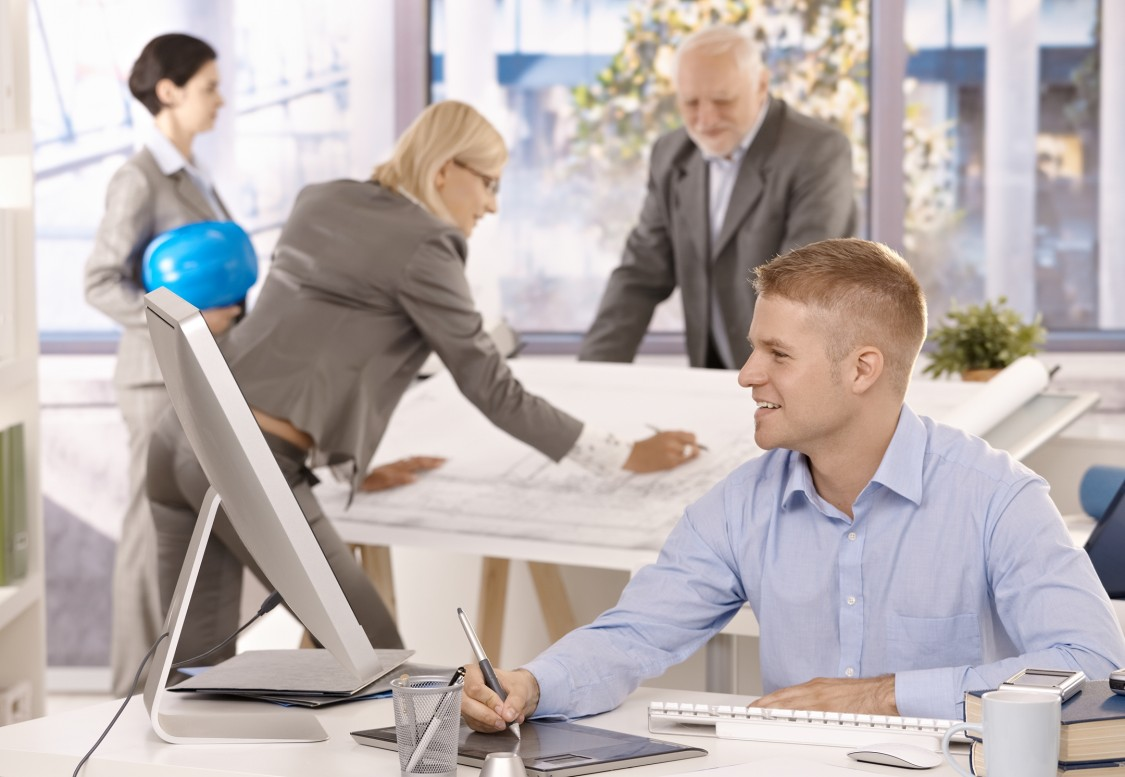 SpecWriter Online image of business people at conference tables