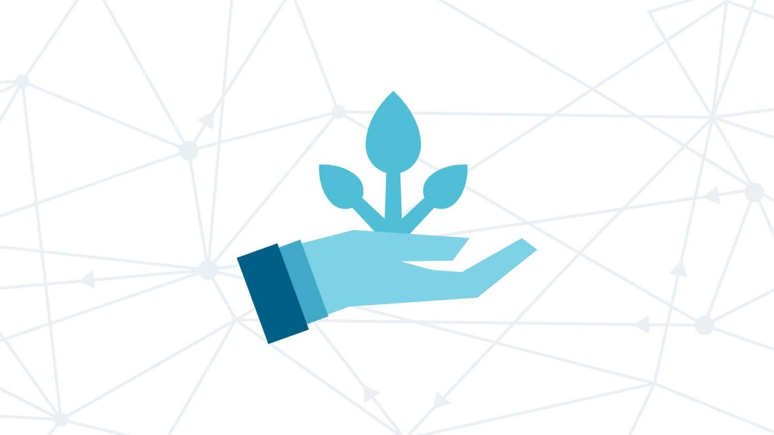 Caring hand with growing plant