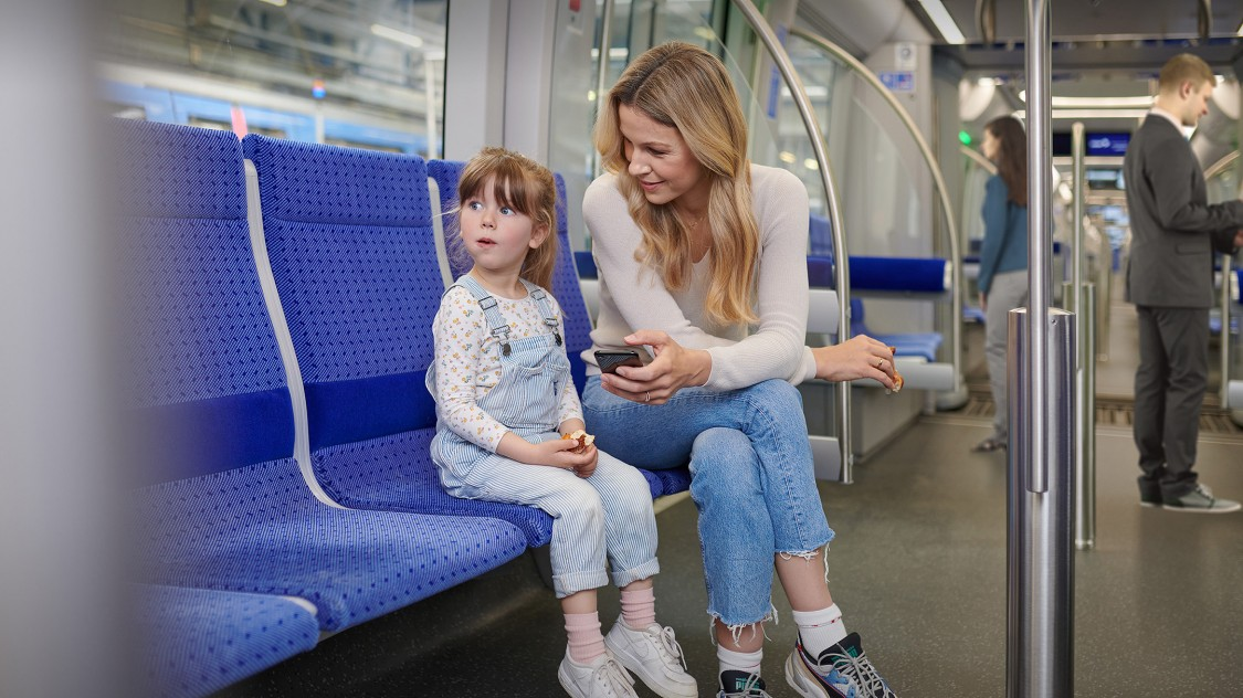 A mother and her daughter in a Siemens Mobility Inspiro Metro in Munich, Germany