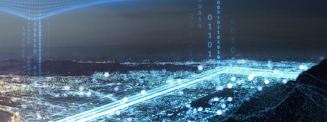 vista noturna de uma cidade com as ruas preenchidas por caminhos de luzes representando a eficiência energética dos microgrids