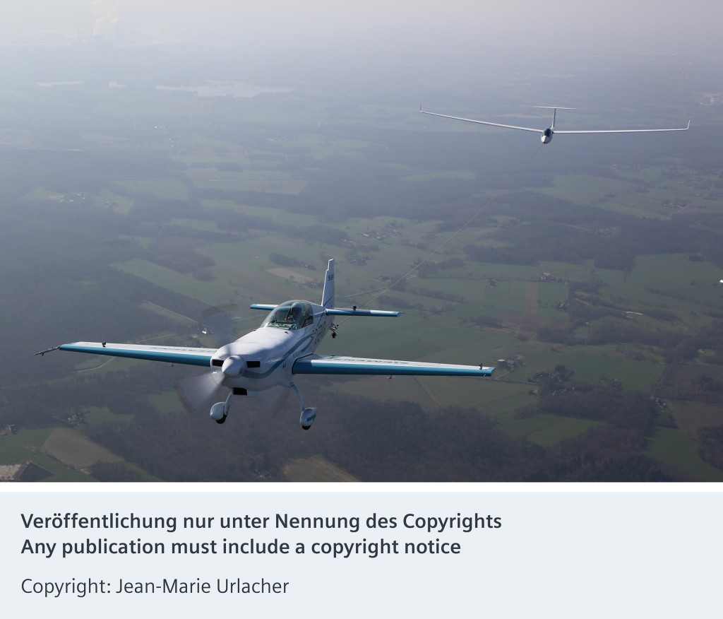 The picture shows the world's first aerotow with an electric plane