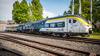 Digital train travels through virtual blue space.