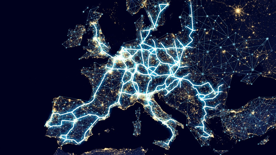 A map of Europe by night with light trails connecting major cities represents the digital transformation of our world