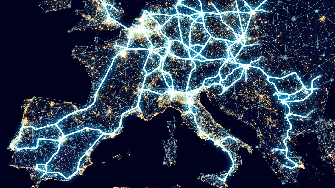 A map of Europe by night with light trails connecting major cities represents the digitalization of mobility