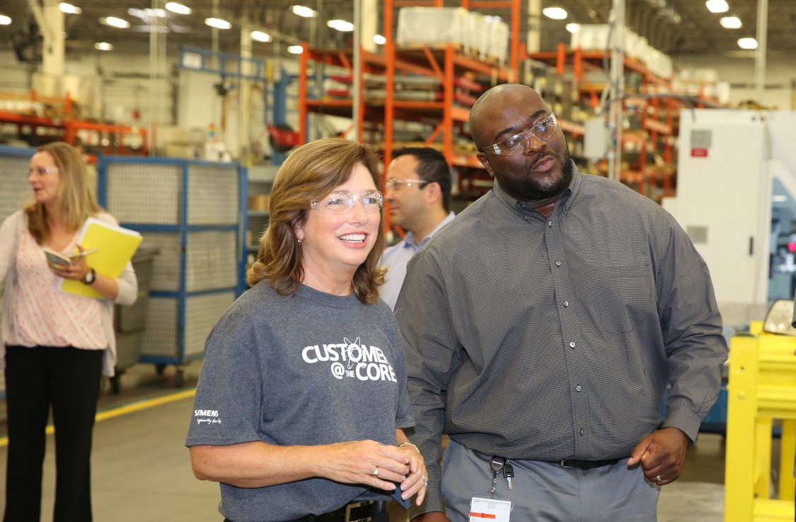 Barbara Humpton and Corey Scales on a factory tour