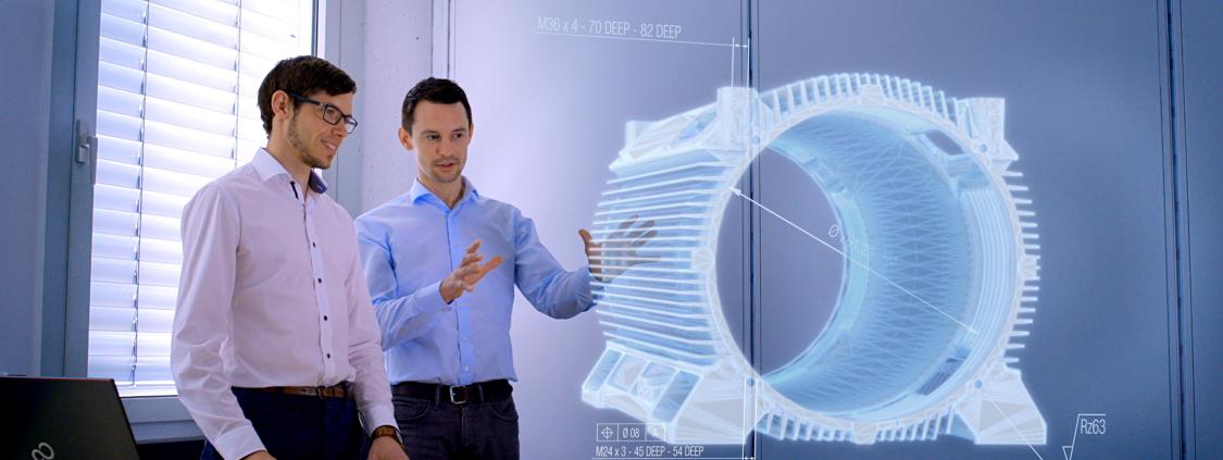 Für eine smarte Fertigung entwickeln die CCT-Experten Christian Lipp und Alexander Nowitschkow 3D CAD-Modelle, die nicht nur die Geometrie, sondern auch nicht-geometrische Informationen wie Toleranzen und Materialeigenschaften enthalten.