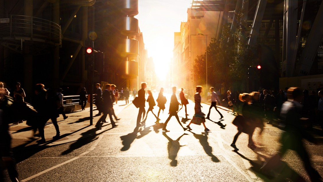 People crossing a street in a city
