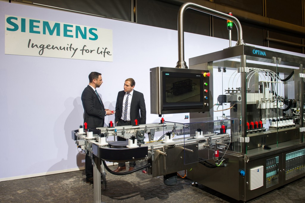 Siemens AG presents its multi-carrier system, jointly developed with Festo for the first pilot customer Optima consumer GmbH, at the Siemens Annual Shareholders' Meeting 2016 at the Olympiahalle in Munich, Germany.