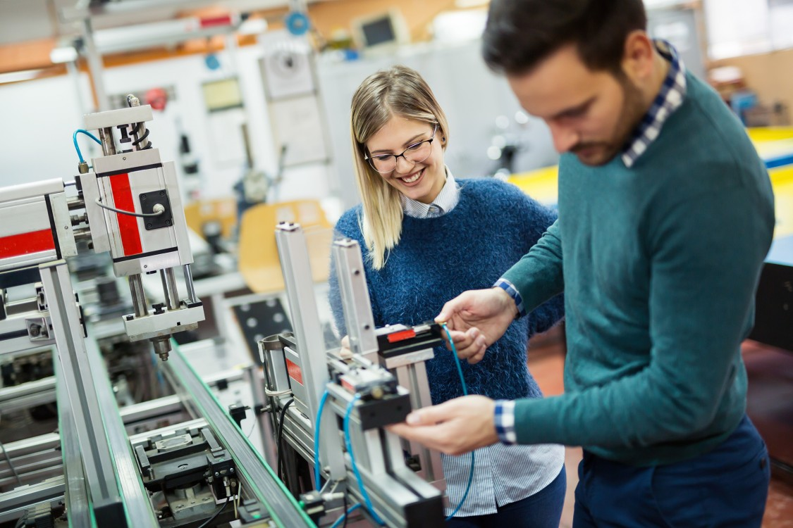 Women engineer working in a factory