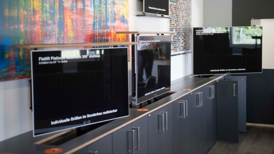Automated retractable screens from Flatlift TV Lift Systeme GmbH of Worms, Germany.