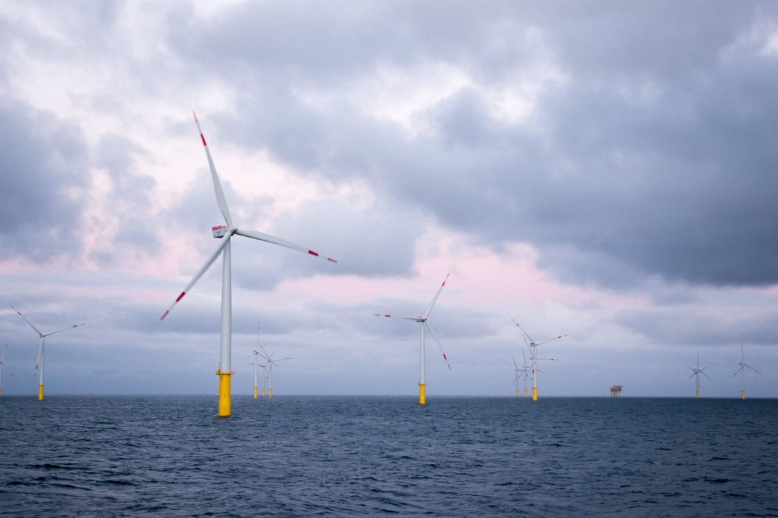 Wind farm with blue and pink background