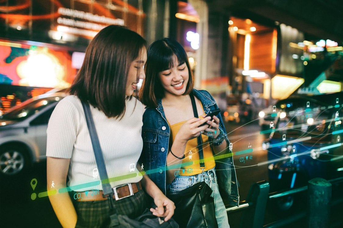 Two inhabitants of a smart city use mobility app designed to meet their urban transport requirements