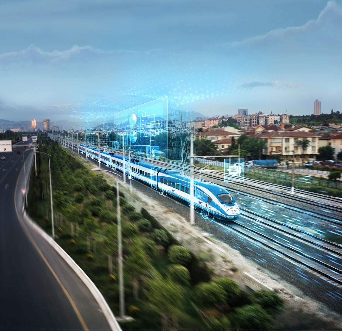 Schnellzug fährt entlang einer Stadt