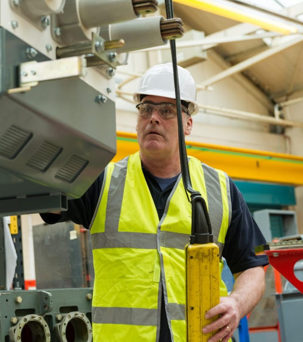 Siemens engineer servicing switchgear
